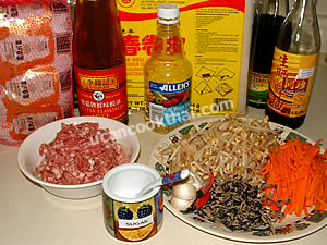 Spring roll ingredients: sauces, ground pork, wrapper, and vegetables