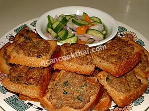 Place fried canapes with pork spread on a plate and serve with cucumber relish