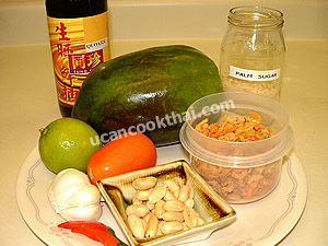 Papaya salad: som tum ingredients: green papaya, dried shrimp, roasted peanut, chillies, sauce and palm sugar