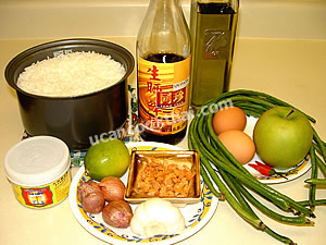 Shrimp paste fried rice ingredients: eggs, apple, long green bean, shallot, garlic, dried shrimp, cooked rice