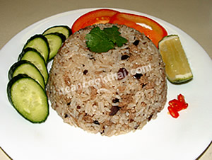 Put salted black olive fried rice on a plate, place side serving ingredients around the rice, and serve immediately