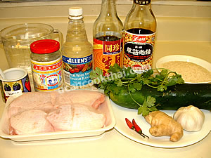 Boiled chicken on rice ingredients: chicken thigh, ginger, garlic, chillies, cucumber, wet bean curd, and sauces