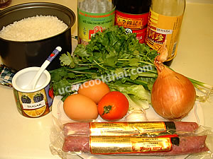 Fermented pork sausage fried rice ingredients: fermented pork sausage, egg, tomato, garlic, onion, green onion, and sauces