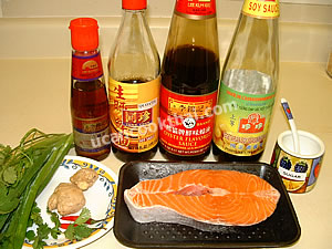 Steamed Salmon in Soy Sauce Ingredients: fresh salmon, ginger, cilantro, sauces, sesame oil