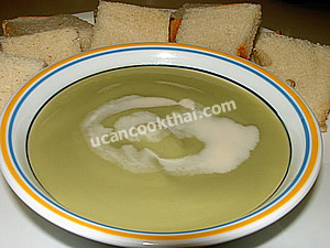 Put Sangkaya in a bowl, top with evaporated milk and serve with bread