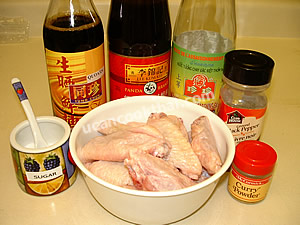 Baked chicken wing ingredients: sauce, sugar, ground pepper, and curry powder
