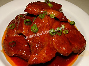 Put Sweet & Sour Pork with Honey on a plate, sprinkle with sliced green onion and serve immediately