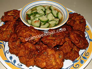 Put fried fish cake on a plate and serve with cucumber relish