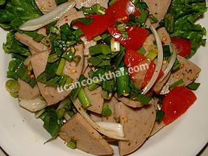 Serving spicy pork roll salad with green lettuce leave