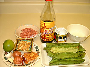 Spicy winged bean salad ingredients: weinged beans, gorund pork, sauce, coconut cream, dried chillies