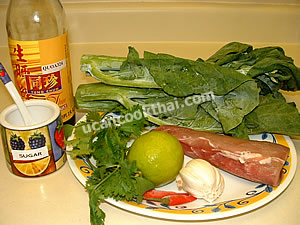 Boiled pork with lime sauce ingredients: pork tenderloin, lime juice, sauce, Chinese broccoli (Gai lan)