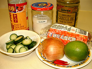 Chinese Sausage Spicy Salad Ingredients: Chinese sausage, cucumber, onion, chilies, lemon juice, soy sauce, sugar, oil