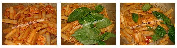 Preparation for stir-fried prawn and heart of palm: Stir well, add sweet basil leaves, stir quickly, and remove from heat