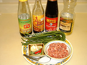 Stir-fried long green beans and ground pork ingredients: ground pork, long green beans, garlic, chillies, and sauces