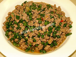 Place stir-fried long green bean and ground pork on a plate and serve immediately