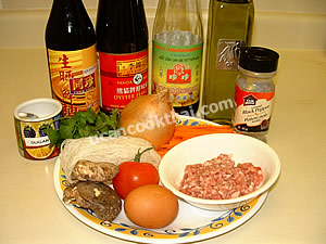 Stir-fried mung bean noodles and ground pork ingredients: mung bean noodles, ground prok, dried shitakae mushrooms, carrot, onion, cilantro, and sauces
