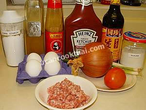 Deep-fried Egg with Ground Pork Sauce Ingredients: eggs, ground pork, tomato, onion, garlic, sauce, sugar, ketchup, corn flour oil