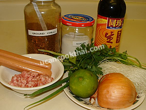 Spicy Mung Bean Noodles and Sausages Salad Ingredients: Sausages, ground pork, mung bean noodles, onion, green onion, cilantro, fish sauce, lime juice, sugar, ground chilies
