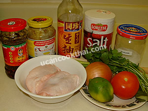 Spicy Steamed-Chicken Salad Ingredients: chicken thigh, lemongrass, kaffir lime leaves, salt, roasted red chili paste, Chinese hot pepper sauce, lime juice, thin soy sauce, sugar, tomato, onion, cilantro, green onion