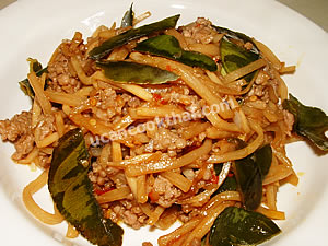 Place Stir-fried Ground Pork with Bamboo Shoots on a plate and serve immediately