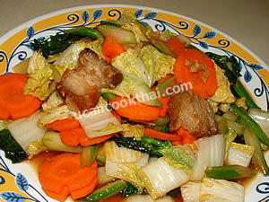 Place stir-fried vegetable with crispy pork on a plate and serve immediately