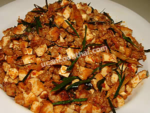 Place stir-fried spicy tofu and ground pork on a plate and serve immediately