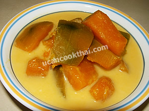 Spoon pumpkin in coconut cream in a bowl and serve immediately
