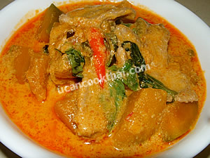 Spoon Pork Red Curry with Pumpkin in a bowl and serve immediately
