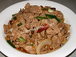 Place Stir-fried Pork with Dried Chilies on a plate and serve immediately