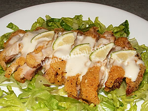 Place crispy chicken on a plate bedding with fresh vegetable, pour lime cream sauce over crispy chicken and serve immediately