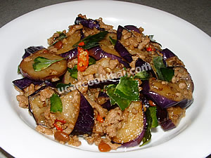 Place stir-fried eggplant with salted soy bean on a plate and serve immediately